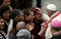 Pope Francis blesses a woman at the end of  his weekly general audience in Paul VI hall at the Vatican on November 30, 2016. UPDATE IMAGES PRESS/Isabella Bonotto<br /> <br /> STRICTLY ONLY FOR EDITORIAL USE