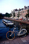 Netherlands: Biking: Amsterdam, Canal Boat.  Photo: dubike101.Photo copyright Lee Foster, 510/549-2202, lee@fostertravel.com, www.fostertravel.com