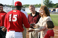 June 19, 2009:  Naomi Silver presents Xavier Scruggs with his championship ring as Brian Paris looks on during a ceremony to award the 2008 NY-Penn League Champions before a game at Dwyer Stadium in Batavia, NY.  The Batavia Muckdogs are the NY-Penn League Short Season Class-A affiliate of the St. Louis Cardinals.  Photo by:  Mike Janes/Four Seam Images