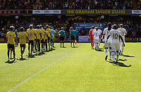 Watford and Swansea players walk on  the pitch   during the Barclays Premier League match Watford and Swansea   played at Vicarage Road Stadium , Watford