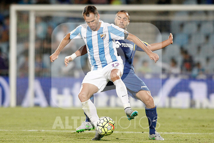 Getafe's Medhi Lacen (r) and Malaga's Duda during La Liga match.September 18,2015. (ALTERPHOTOS/Acero)