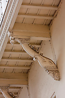 Zanzibar, Tanzania.  South Asian Influence in Architectural Design, Stone Town.  Elephant Head Supports Overhead Balcony.