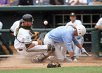 North Carolina's Ben Bunting scores as the ball gets away from Vanderbilt's Curt Casali during the second inning. Vanderbilt won 7-3 to open the 2011 College World Series in Omaha, Neb. (Photo by Michelle Bishop)..