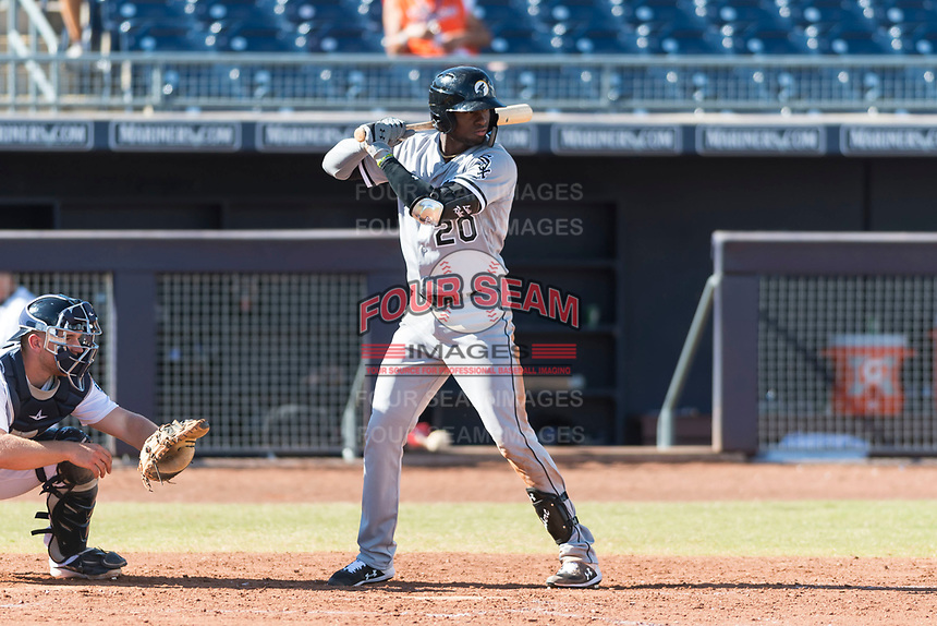 Glendale Desert Dogs designated hitter Luis Robert (20), of the Chicago White Sox organization, at bat during an Arizona Fall League game against the Peoria Javelinas at Peoria Sports Complex on October 22, 2018 in Peoria, Arizona. Glendale defeated Peoria 6-2. (Zachary Lucy/Four Seam Images)