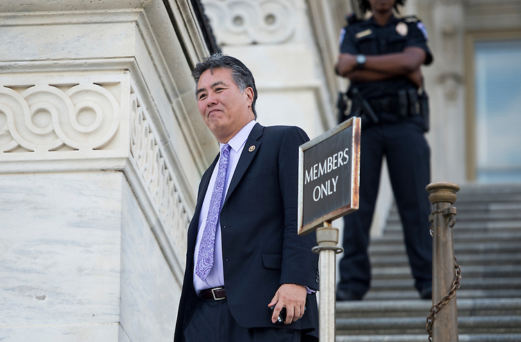 UNITED STATES - JULY 29: Rep. Mark Takano, D-Calif., walks down the House steps at the Capitol following the final votes before the August recess on Wednesday, July 29, 2015. (Photo By Bill Clark/CQ Roll Call)