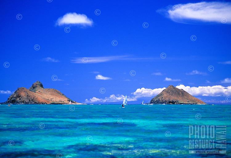 Sailboat between the Moku lua islands. View from Lanikai beach