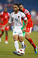 Guadeloupe midfielder Stephane Auvray (18) dribbles the ball during the CONCACAF soccer match between Panama and Guadeloupe at Ford Field Detroit, Michigan.