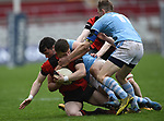Stephen Sheahan of Ennis  in action against Harry Byrne and Kevin Le Gear of Garryowen during their U-18 Munster Club Final at Thomond Park. Photograph by John Kelly.
