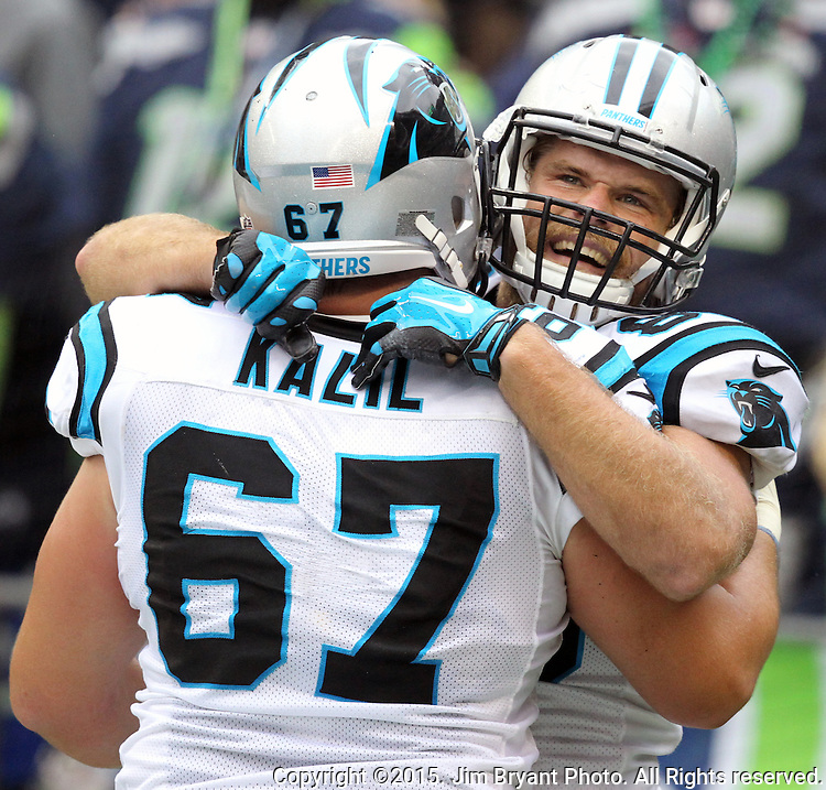 Carolina Panthers tight end Greg Olsen (88) celebrates with center Ryan Kalil (67) at CenturyLink Field in Seattle on October 18, 2015 after catching the winning touchdown against the Seattle Seahawks. The Panthers came from behind with 32 seconds remaining in the 4th Quarter to beat the Seahawks 27-23.  ©2015 Jim Bryant Photography. All Rights Reserved.