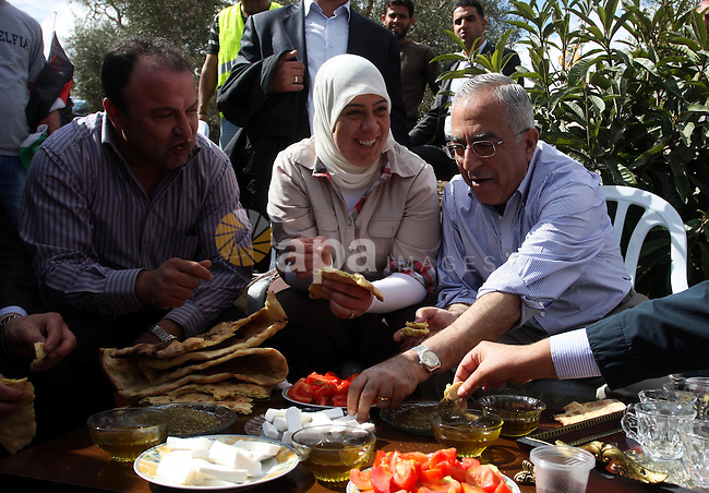Palestinian Prime Minister Salam Fayyad tours in the village of Nabi Salah, north of Ramallah, 31 October 2011, in supporting Palestinian farmers during the olive harvest and against Israeli settlers attacks on Palestinian farmers. Photo by Issam Rimawi