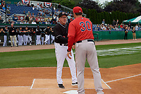 Batavia Muckdogs manager Tom Lawless (10) shakes hands with Luke Montz (30) during introductions before a NY-Penn League Semifinal Playoff game against the Lowell Spinners on September 4, 2019 at Dwyer Stadium in Batavia, New York.  Batavia defeated Lowell 4-1.  (Mike Janes/Four Seam Images)