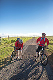 USA, Hawaii, The Big Island, journalist Daniel Duane and chef Seamus Mullens get ready to mountain bike on Mana Road at the base of the Kiluea volcano