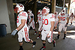 Wisconsin Badgers offensive and defensive linemen walk down the tunnel to the field prior to the 2012 Rose Bowl NCAA football game against the Oregon Ducks in Pasadena, California on January 2, 2012. The Ducks won 45-38. (Photo by David Stluka)