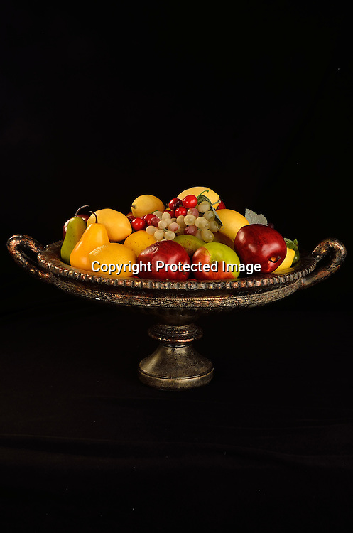 Photo of colorful bouquet of fresh fruits. The fruits are on a beautiful vintage setting.