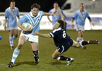Cambridge University / Oxford University..24th PCubed Student Rugby League Varsity Match..Richmond Athletic Ground, March 3, 2004..Pic : Max Flego ..Andrei Bettinson powers through the tackle of Graham Barr