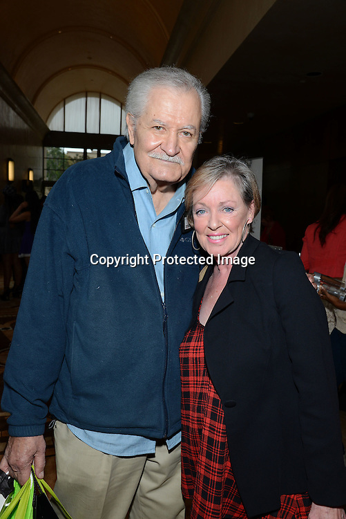John Aniston and wife Sherry attends the 2015 Daytime Emmy Gifting Suite on April 25, 2015 at Warner Brothers Stuido Lot  in Burbank, California, USA. The gift lounge was presented by OffTheWallIdeas.com.