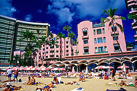 "The beach side of the fabulous Royal Hawaiian Hotel, or """"pink palace"""", a Waikiki historic landmark."
