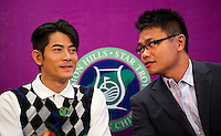 HAIKOU, CHINA - OCTOBER 28:  Hong Kong singer and film actor Aaron Kwok (L) talk with Dr. Ken Chu, Vice Chairman of Mission Hills Group during a press conference as part of the Mission Hills Star Trophy on October 28, 2010 in Haikou, China. The Mission Hills Star Trophy is Asia's leading leisure liflestyle event and features Hollywood celebrities and international golf stars.  Photo by Victor Fraile / studioEAST