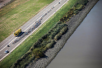 "Peloton riding though the Port of Antwerp. <br /> <br /> Antwerp Port Epic 2018 (formerly ""Schaal Sels"")<br /> One Day Race: Antwerp > Antwerp (207km of which 32km are cobbles & 30km is gravel/off-road!)"