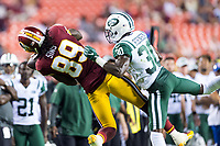 Landover, MD - August 16, 2018: Washington Redskins wide receiver Cam Sims (89) beats New York Jets cornerback Juston Burris (32) for a big gain to set up the game winning field goal late in the 4th quarter of preseason game between the New York Jets and Washington Redskins at FedEx Field in Landover, MD. (Photo by Phillip Peters/Media Images International)