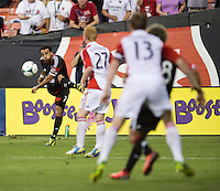 Dwayne De Rosario (7) of D.C. United takes a shot during a game at RFK Stadium in Washington, DC.  D.C. United tied Toronto FC, 1-1.