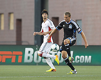 San Jose Earthquakes forward Adam Jahn (14) controls the ball as New England Revolution defender Stephen McCarthy (15) closes. In a Major League Soccer (MLS) match, the New England Revolution (white) defeated San Jose Earthquakes (black), 2-0, at Gillette Stadium on July 6, 2013.