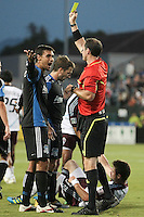 San Jose Earthquakes forward Chris Wondolowski (8) received a yellow card from referee Paul Ward. during the Colorado Rapids 2-1 victory over the San Jose Earthquakes at Buck Shaw Stadium in Santa Clara, California.