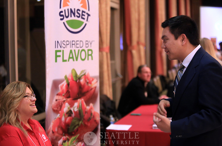 January 27th, 2016-  Costco &amp; You event at Seattle University. <br /> <br /> Seattle U student Ryan Lim, right, networks with vendors from Costco and other companies.