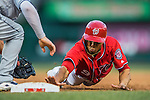 23 July 2016: Washington Nationals outfielder Ben Revere dives safely back to first on a pick-off attempt during play against the San Diego Padres at Nationals Park in Washington, DC. The Nationals defeated the Padres 3-2 on a Stephen Drew pinch-hit, walk-off triple in the bottom of the 9th inning to tie their series at one game apiece. Mandatory Credit: Ed Wolfstein Photo *** RAW (NEF) Image File Available ***