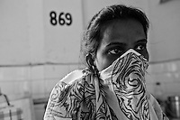A female patient with her face covered in the womens ward at the Rajan Babu TB hospital in new Delhi, India.