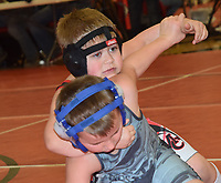 RICK PECK/SPECIAL TO MCDONALD COUNTY PRESS<br /> Chandler Moffett of the McDonald County Youth Wrestling Club takes Noah Midcap of Webb City down on his way to a 9-4 win in the six and under, 55-pound division at the McDonald County Youth Wrestling Tournament held Dec. 29 at MCHS.