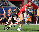 Simon Zebo of Munster tackled by Magnus Lund of Sale Sharks - European Rugby Champions Cup - Sale Sharks vs Munster -  AJ Bell Stadium - Salford- England - 18th October 2014  - Picture Simon Bellis/Sportimage