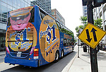 A Megabus coach approaches a stop west on Van Buren street, Friday, June 3, 2016, in downtown Chicago, IL. (DePaul University/Jeff Carrion)