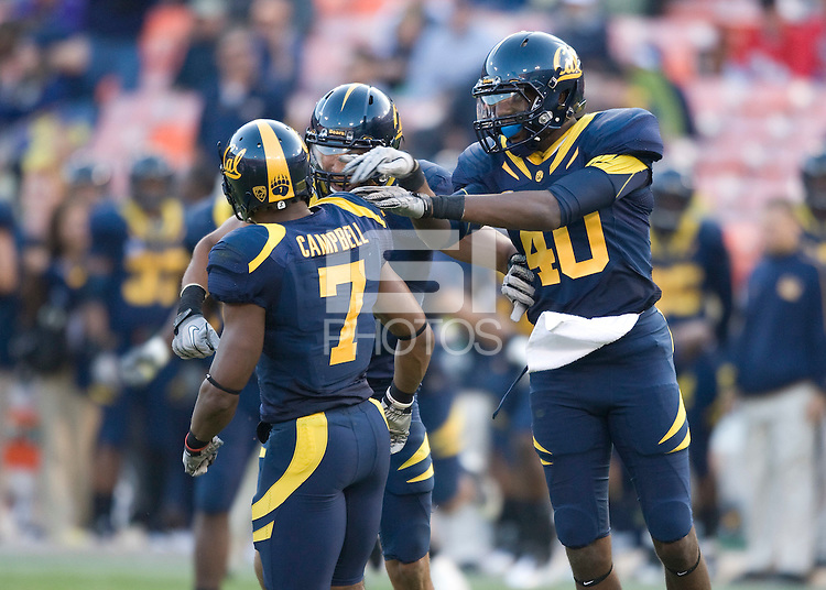 D.J. Campbell of California gets celebrated by Sean Cattouse and Chris McCain after Campbell made a big play during the game against Fresno State at Candlestick Park in San Francisco, California on September 3rd, 2011.  California defeated Fresno State, 36-21.
