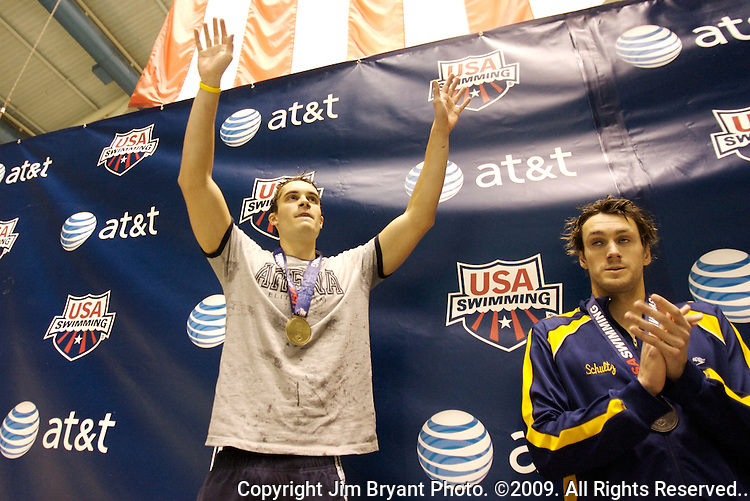 Eric Shanteau, left, raises his arms in victory to after receiving the gold medal  in the Men 200 Yard Individual Medley at the AT & T Short Course National Championships in Federal Way, WA., on Thursday, Dec. 3, 2009. Shanteau won with a time of 1:44.74, while  Andre Schult, right,  placed second with a time of 1:45.67. Jim Bryant Photo. ©2009. All Rights Reserved.....