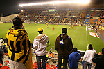 "Beitar Jerusalem soccer fans holding yellow and black flags support their team during the the match for the league against Bnei Sachnin in the Jerusalem stadium ""Tedy"". Bnei Sachnin is the only Arab club in the Israeli Prime League, as a result of that the Betar chants are specially racist during the games between the clubs . Beitar Jerusalem FC was founded in the 1930's by the right-wing Revisionist Zionist movement, which later formed the Israeli Likud political party, during the British Mandate rule over Palestine. The chanting of the club is racist and mainly against Arabs. The team is the only one in the Israeli league to have never had an Arab player. Beitar is seen as the right wing and Mizrahi (Jews who came from Asia and Africa) club. Photo by Quique Kierszenbaum"
