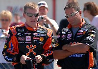 Apr 28, 2007; Talladega, AL, USA; Nascar Nextel Cup Series driver Jeff Burton (31) talks with a crew member during qualifying for the Aarons 499 at Talladega Superspeedway. Mandatory Credit: Mark J. Rebilas
