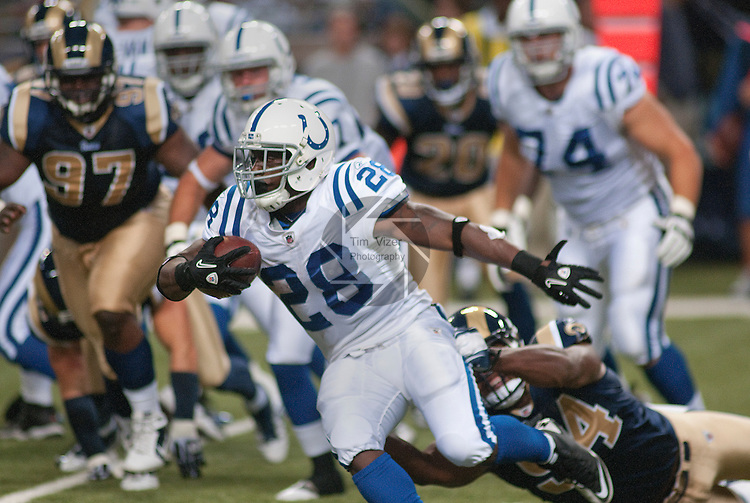 13 August 2011                                Indianapolis Colts running back Chad Spann (28) is dragged down by St. Louis Rams defensive end Robert Quinn (94) after Spann got the handoff from the quarterback in second half action. The St. Louis Rams defeated the Indianapolis Colts 33-10 in a pre-season football game at the Edward Jones Dome in downtown St. Louis, Missouri on Saturday August 13, 2011.