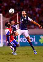 SAN JOSE, COSTA RICA - September 06, 2013: Omar Gonzalez (3) of the USA MNT chests the ball away from Joel Campbell (12) of the Costa Rica MNT during a 2014 World Cup qualifying match at the National Stadium in San Jose on September 6. USA lost 3-1.