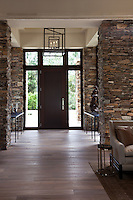 Stone columns blur the lines between inside and outside space of this foyer