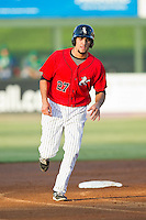 Nick Basto (27) of the Kannapolis Intimidators rounds second base during the South Atlantic League game against the Lexington Legends at CMC-Northeast Stadium on July 29, 2013 in Kannapolis, North Carolina.  The Intimidators defeated the Legends 10-5.  (Brian Westerholt/Four Seam Images)