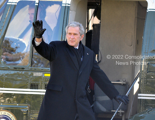 Washington, D.C. - January 16, 2009 -- United States President George W. Bush waves to supporters as he departs the South Lawn of the White House aboard Marine 1 for his final week-end as President at the presidential retreat at Camp David, Maryland on Friday, January 16, 2009..Credit: Ron Sachs / Pool via CNP