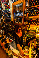 Bartender serving wine at Carmela tapas bar, Granada, Granada Province, Andalusia, Spain.