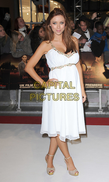 Una Healy of The Saturdays.'The Twilight Saga: Breaking Dawn - Part 1' UK film premiere at Westfield Stratford City, London, England..16th November 2011.full length hand on hip white dress gold trim pregnant side.CAP/BEL.©Tom Belcher/Capital Pictures.