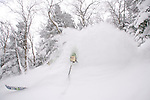 Skiers enjoying deep Vermont powder, Jay Peak, Vermont