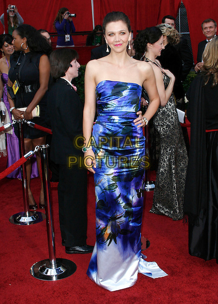 MAGGIE GYLLENHAAL.The 82nd Annual Academy Awards held aat The Kodak Theatre in Hollywood, California, USA..March 7th, 2010.oscars full length strapless blue print patterned pattern printed dress hand on hip green stone bracelet white maxi cuff .CAP/EAST.©Eastman/Capital Pictures.