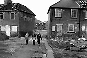 Children in a street in the former pit village of Grimethorpe, South Yorkshire 1999, which has undergone serious decline since its colliery closed in 1993, and where many ex-miners' houses are empty and vandalised.
