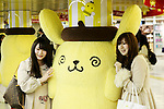 Shinjuku station commuters squeeze and pose for a picture with Sanrio's character Pom Pom Purin or Purin plush dolls displayed along in the Tokyo Metro Promenade on March 8, 2016, Tokyo, Japan. 11 of the huge cuddly characters will be displayed in an underground passage of Shinjuku Station until March 13, as a part of the celebrations for the 20th Birthday of Pom Pom Purin. Sanrio is a Japanese company established in 1963, which has created over 400 cute characters, including the worldwide known Hello Kitty. (Photo by Rodrigo Reyes Marin/AFLO)