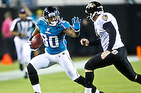 October 24, 2011:   Jacksonville Jaguars wide receiver Mike Thomas (80) returns a punt during first half action between the Jacksonville Jaguars and the Baltimore Ravens played at EverBank Field in Jacksonville, Florida.  ........
