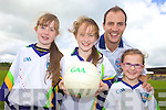 SISTERS: Duagh sisters, Kylie, Margaret and Michelle Walsh learning the skills from Tadhg Kennelly at the VHI GAA Cu?l Camp in Duagh last Friday.
